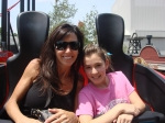 Me, (Cindy Bell), and my daughter, Cara, on 'Tony Hawks Big Spin' at Six Flags Over Texas.