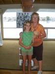 Katrin Hecht Bandhauer and daughter, Lorien, decorating the Pavilion with their enlarged team and club photos